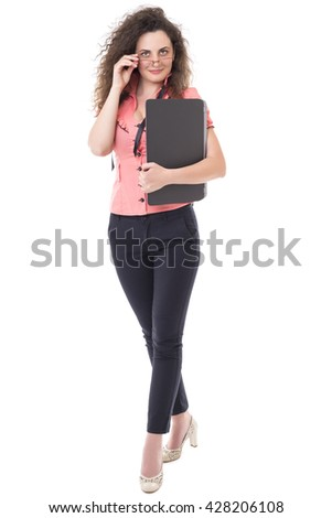 Beautiful young businesswoman holding her laptop isolated on white background - stock photo