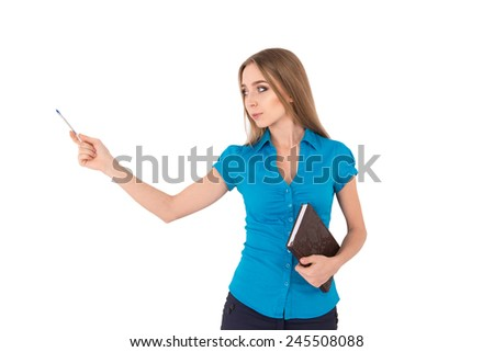 Beautiful young businesswoman in shirt pointing away while standing against white background.  - stock photo