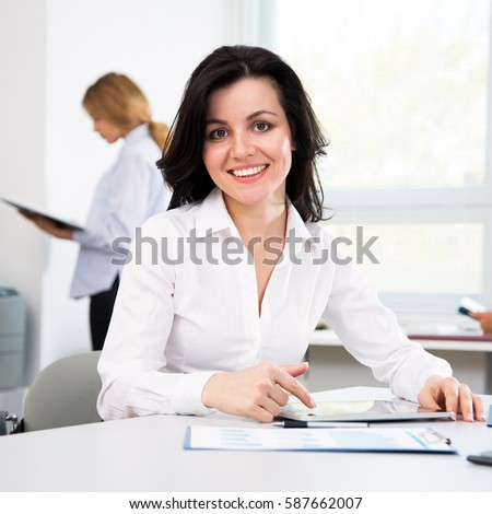 Beautiful young businesswoman in the modern office