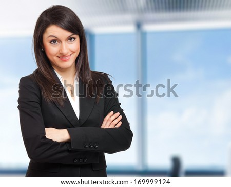 Beautiful young businesswoman portrait in a modern office