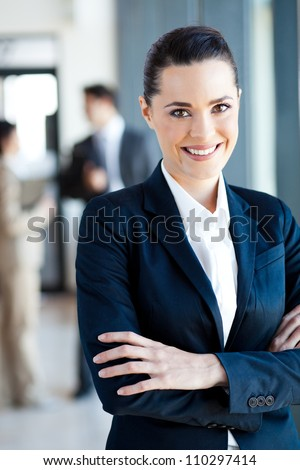 beautiful young businesswoman portrait in office - stock photo