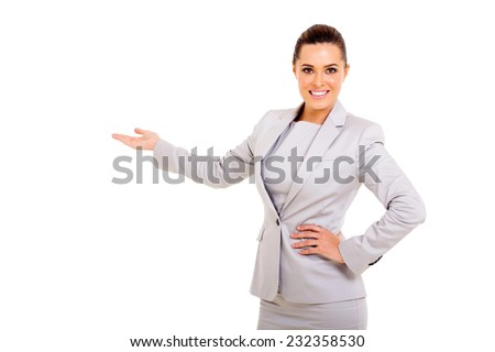 beautiful young businesswoman presenting empty space - stock photo