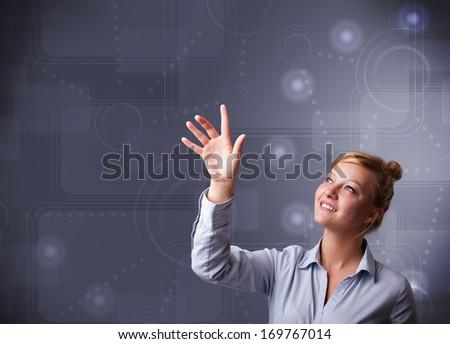 Beautiful young businesswoman touching copy space - stock photo