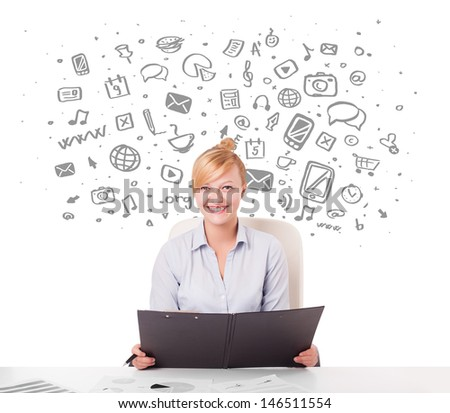 Beautiful young businesswoman with all kind of hand-drawn media icons in background - stock photo