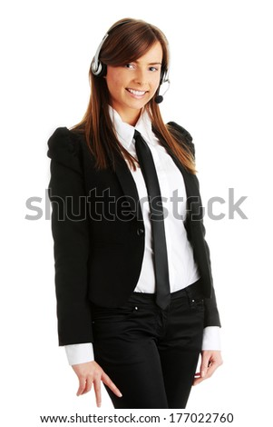 Beautiful young call-centre assistant smiling at the camera - stock photo