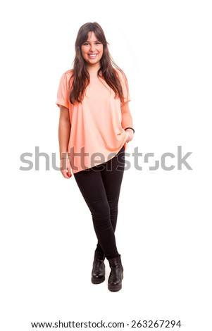 Beautiful young casual woman posing isolated over white