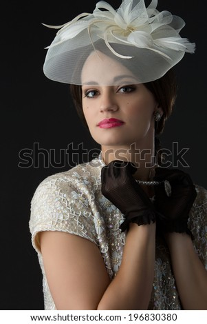 Beautiful young caucasian girl wearing vintage clothing accessories and jewelry.