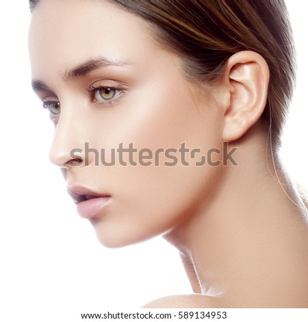 Beautiful young caucasian girl with natural makeup profile. Woman portrait.