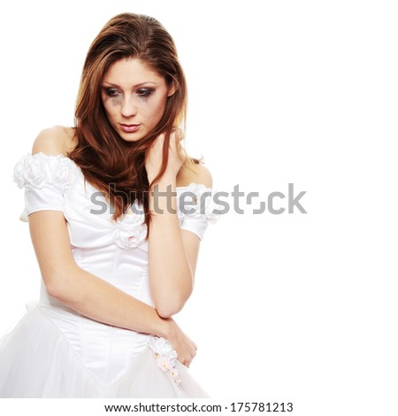 Beautiful young caucasian sad bride crying, over white background