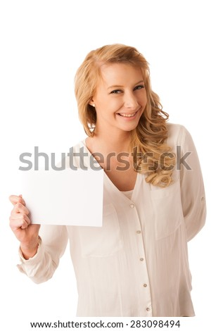 Beautiful young caucasian woman holding a blank white board in her hand isolaetd over white background - stock photo