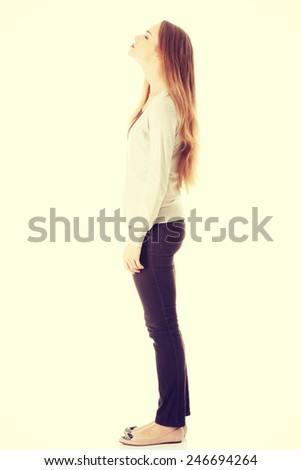 Beautiful young caucasian woman is looking up.  - stock photo