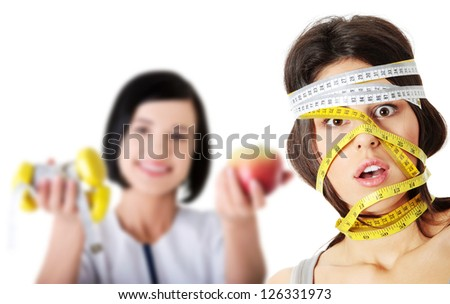 Beautiful young caucasian woman with measuring tape around her head, isolated on white. Diet concept