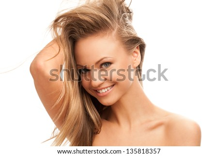 Beautiful young caucasian woman with natural makeup isolated over white background