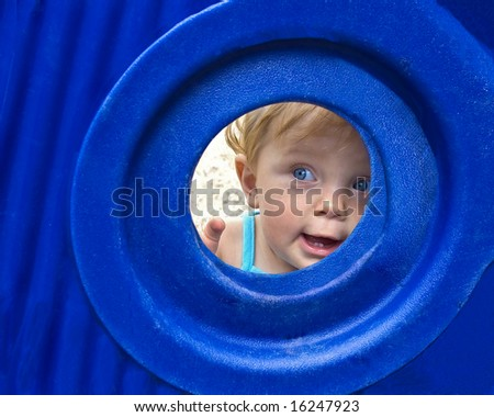beautiful young child at playground - stock photo