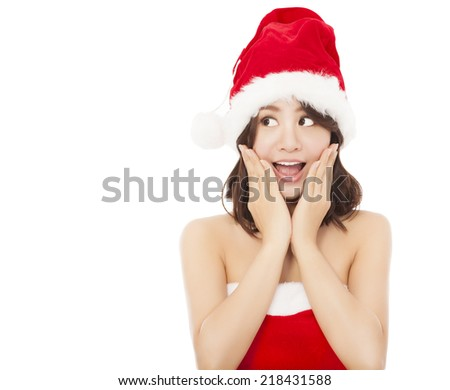 beautiful young christmas woman making a funny expression over white background - stock photo