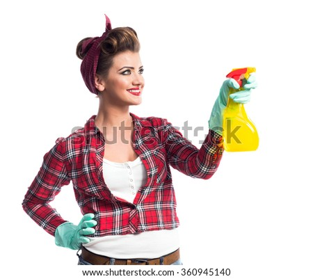 Beautiful young cleaner - stock photo