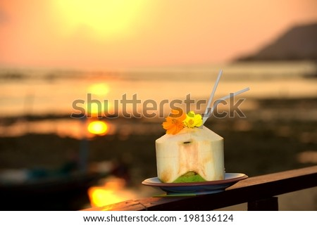 Beautiful young coconut in tropical beach against sunset Koh Samui Thailand - stock photo