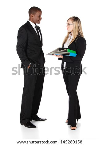 Beautiful young confident businesswomen wearing glasses and a black business suit with a white collar shirt and a handsome african businessman. She is holding blue and green files.