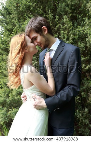 Beautiful young couple, bride and groom, tenderness and love - stock photo