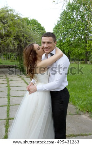 Beautiful young couple, bride and groom, tenderness and love