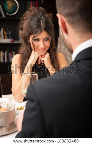 Beautiful young couple dating at the restaurant. - stock photo