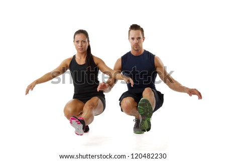 Beautiful young couple doing one leg squat fitness exercise