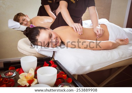 Beautiful young couple enjoy together a massage at spa centre  - stock photo