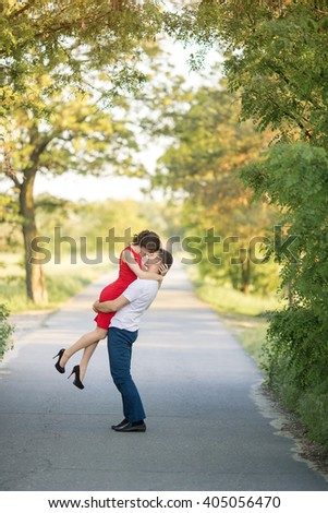 Beautiful Young Couple Have Romantic Dating in Park. Happy Man and Woman Kissing and Fall in Love Outdoor. Relationships - stock photo
