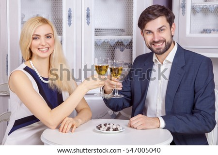 Beautiful Young couple having fun together in valentine days. drinking white wine and enjoying their good romantic dating.