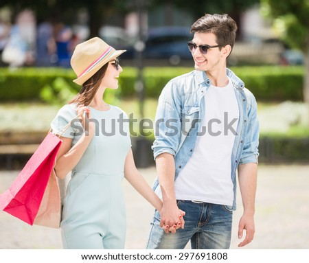 Beautiful young couple having shopping together on summer day in european city. - stock photo