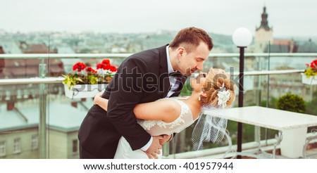 beautiful young couple hugging outdoors - stock photo