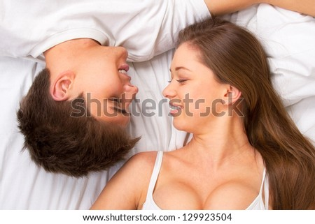 Beautiful young couple in bed, face portrait - stock photo