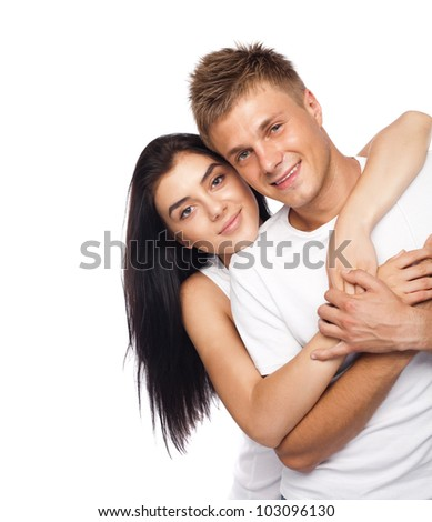 Beautiful young couple in casual clothing isolated on white background