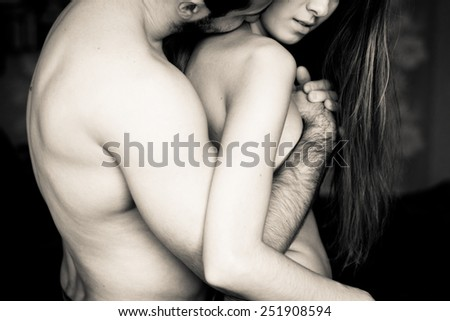 Beautiful young couple in love hugging indoor - stock photo