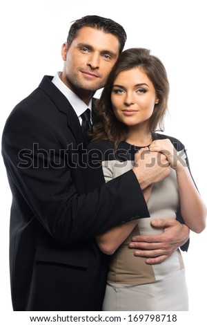 Beautiful young couple in suit and dress isolated on white background