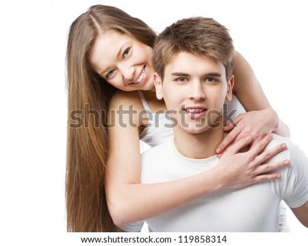 Beautiful young couple isolated on white background - stock photo