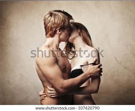Beautiful young couple kissing - stock photo