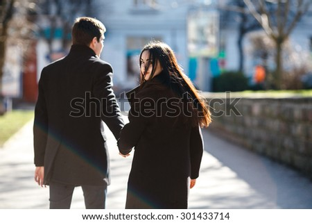 beautiful young couple meets against the backdrop of the city - stock photo