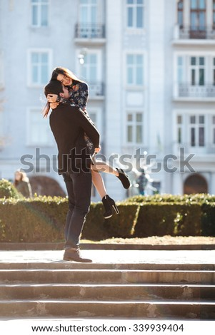 beautiful young couple meets against the backdrop of the city