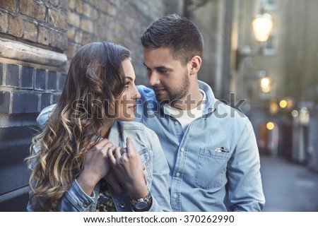 beautiful young couple on a walk on one of London's streets - stock photo