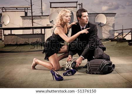 beautiful young couple on the roof - stock photo