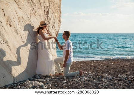 Beautiful young couple  on the seacoast, Cyprus - stock photo