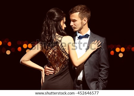 Beautiful young couple posing in the dark