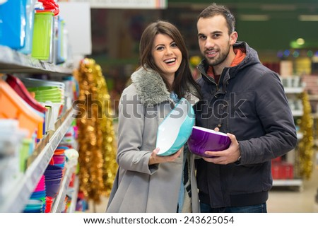Beautiful Young Couple Shopping For Bowl In Produce Department Of A Grocery Store - Supermarket - Shallow Deep Of Field