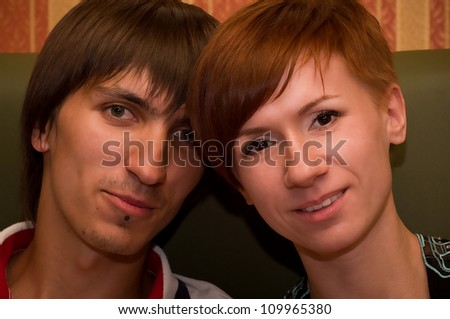 Beautiful young couple smiling together - stock photo