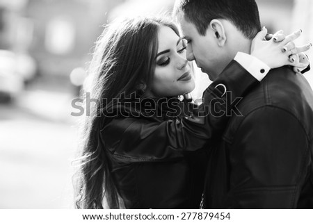 beautiful young couple tenderly embracing each other - stock photo