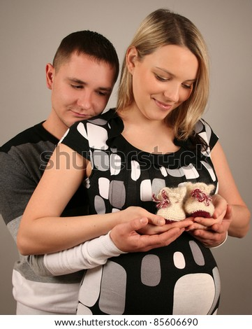 beautiful young couple waiting baby