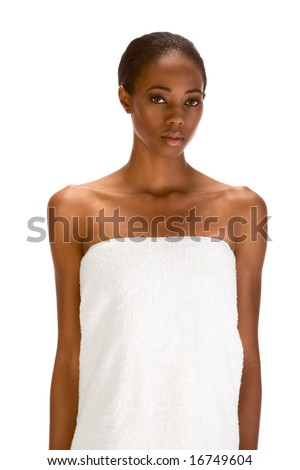 Beautiful young dark skinned woman with Slicked Back Hair wrapped in white bath towel preparing for sauna - stock photo