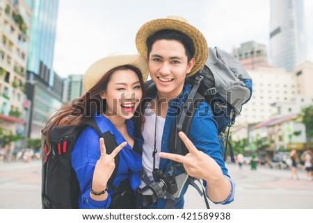 Beautiful young dating couple in city taking photos. - stock photo