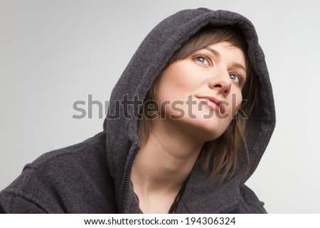 beautiful young daydreaming  woman wearing a man's jacket - stock photo